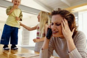 Stressed Mother on Telephone --- Image by © Goodshoot/Corbis