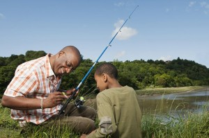 BATH --- Father and son fishing --- Image by © Colin Hawkins/cultura/Corbis
